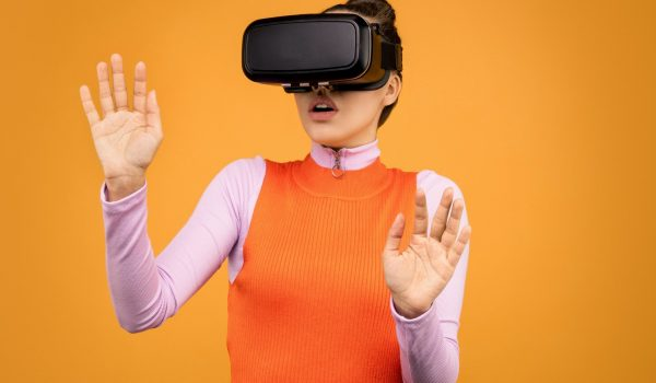 woman-in-long-sleeve-shirt-wearing-vr-goggles-3761308